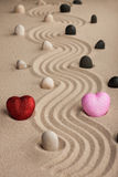 Two conceptual heart in the sand Stock Images