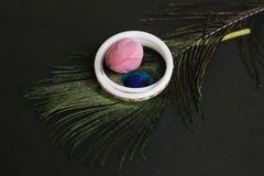 Two conch-bangle on peacock feather eye with pink flower lotus. Royalty Free Stock Photos