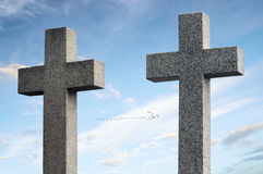 Two concrete crosses against sky and trees Stock Images