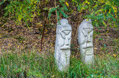 Two concrete totem poles Stock Image