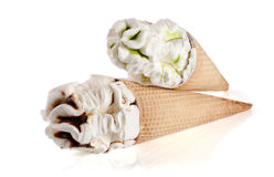 Two cones of ice creams with chocolate isolated white background Stock Photos