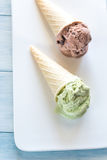 Two cones of nut-flavored ice cream Royalty Free Stock Photography