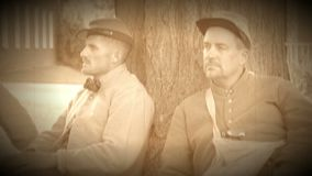 Two confederate Civil War soldiers near tree (Archive Footage Version). View of Two confederate Civil War soldiers near tree (Archive Footage Version stock footage