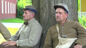 Two confederate Civil War soldiers near tree. View of Two confederate Civil War soldiers near tree stock video footage