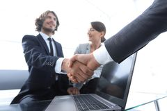 Two confidence businessman shaking hands close-up stock photography