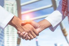 Two confident arab businessman shaking hands. Successful business partners. Negotiating business. Stock Photography