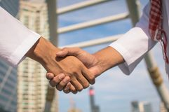 Two confident arab businessman shaking hands. Successful business partners. Negotiating business. Royalty Free Stock Photo