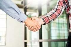 Two confident business man shaking hands during a meeting in the royalty free stock photo