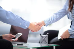 Two confident business man shaking hands during a meeting in office, success, dealing, greeting and partner concept. royalty free stock images