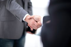 Two confident business man shaking hands during a meeting in office, success, dealing, greeting and partner concept. stock photos