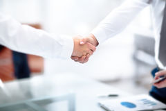 Two confident business man shaking hands during a meeting in office, success, dealing, greeting and partner concept. Royalty Free Stock Image