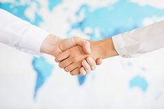 Business handshake and business people.Vintage tone Retro filter effect,soft focus,low light. Royalty Free Stock Photos