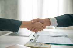 Two confident business man shaking hands during a meeting in the royalty free stock images