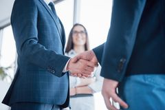 Two confident business man shaking hands during a meeting in the office, success, dealing, greeting and partner concept stock photos