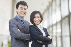 Two Confident Business People with Arms Crossed Looking at Camera stock photography