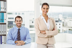 Two confident business people in office Royalty Free Stock Photography