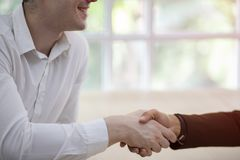 Two confident businessman shaking hands. Successful business partners. Negotiating business. royalty free stock photography