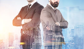 Two confident businessmen in a morning city Royalty Free Stock Image