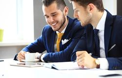 Two confident businessmen networking Stock Image