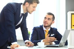 Two confident businessmen networking. In office stock photos