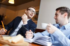 Men organizing work Royalty Free Stock Image