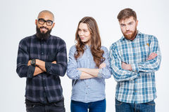 Two confident men and one woman standing with arms crossed Royalty Free Stock Photo