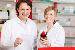 Two confident pharmacists at work Royalty Free Stock Photo
