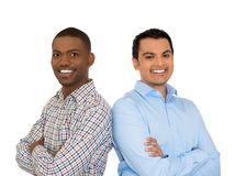 Two confident smiling businessmen arms crossed Stock Photos
