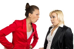 Two conflicted business women in office Royalty Free Stock Photos