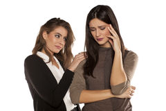 Two confronting friends. Young women comforting her crying friend Royalty Free Stock Images