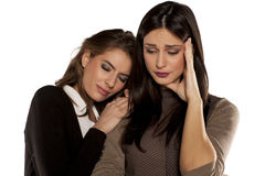 Two confronting friends. Young women sympathizes with her crying friend Royalty Free Stock Images