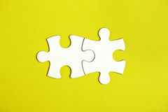 Two connected jigsaw puzzle pieces Royalty Free Stock Photo