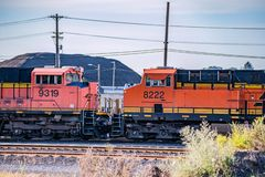 Two connected locomotive trains royalty free stock photography