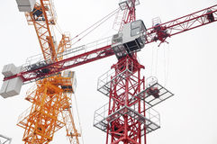 Two Construction crane. On the  white  background Stock Photos