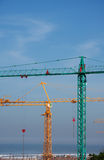 Two construction cranes Royalty Free Stock Photos