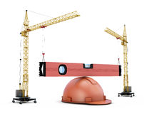 Two construction cranes raise the construction level lying on a Stock Image