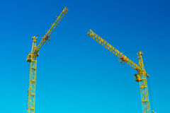 Two construction cranes in sky Stock Photo