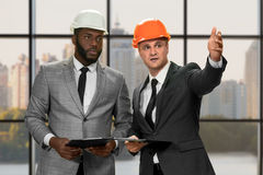 Two construction managers' daytime conversation. Royalty Free Stock Photo