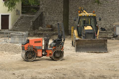Two construction vehicles in building land Stock Photos