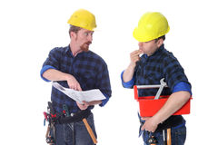Two construction workers with architectural plans Stock Photo