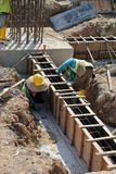 Two construction workers fabricating ground beam formwork Stock Images