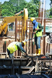 Two construction workers fabricating ground beam steel reinforcement bar Stock Photography