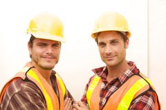 Two Construction Workers at the job. Working together Royalty Free Stock Images
