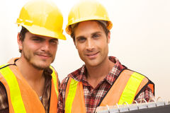 Two Construction Workers at the job. Working together Stock Images