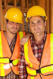 Two Construction Workers at the job. Working together Royalty Free Stock Photo