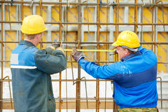 Two construction workers making reinforcement Stock Photos