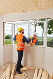Two construction workers during modernization. Of house royalty free stock photo