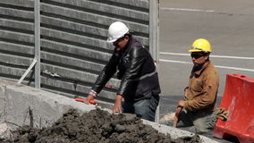 Two construction workers resting a moment. Mexico City, Mexico-August 2014: Two construction workers resting a moment. Nowadays the construction business is stock video