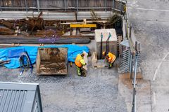 Two construction workers at the sites storage area searching for material, Stockholm Sweden. Two construction workers at the construction sites storage area stock images
