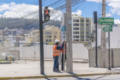 Two Construction Workers Talking at the Sidewalk in Quito Ecuado Royalty Free Stock Image